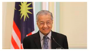 Malaysia's Prime Minister Mahathir resigns but is asked remains as interim PM